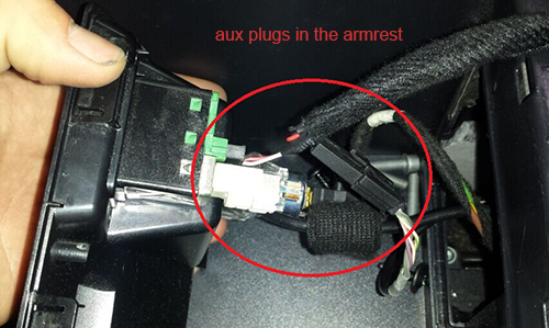 aux plug in the armrest